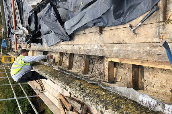 Removal-of-rotten-gutter-boards,-cleaning-wall-head-before-new-timber-bases-are-installed